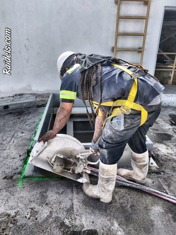Hand Sawing on a Roof
