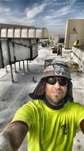Cutting walls on a roof in a Broward Hospital.